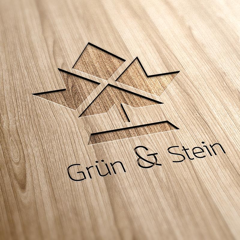 Eine Interpretation für die Markenentwicklung und des Logodesigns des StartUp-Pakets. Es ist ein in Holz verarbeitetes Ahornblatt-Muster in modernem Design mit einer Firmennamenunterschrift zu sehen.
