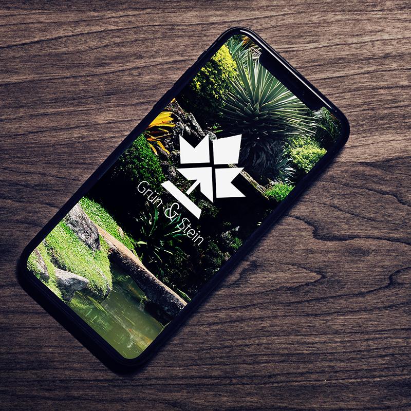 Inspirationsquelle für den eigenen Eindruck im Bereich Logo und Design. Dargestellt als Smartphone, welches ein individuelles Logo und Webdesign abbildet.